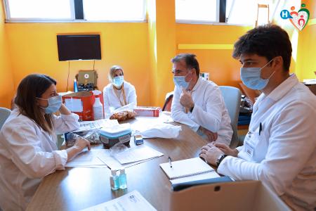 Fotografia di Simone Durante che ritrae una riunione di medici