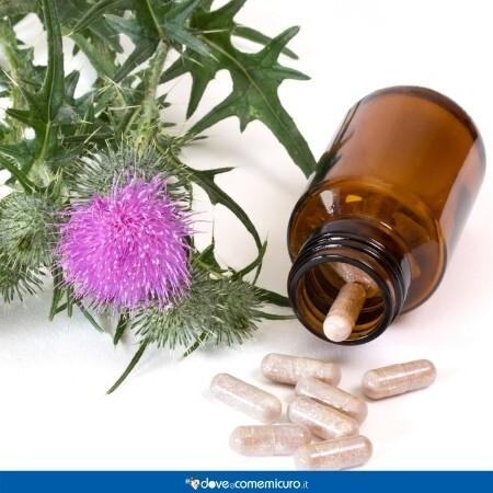 Immagine che rappresenta pillole dai fiori di Silybum Marianum o cardo Mariano