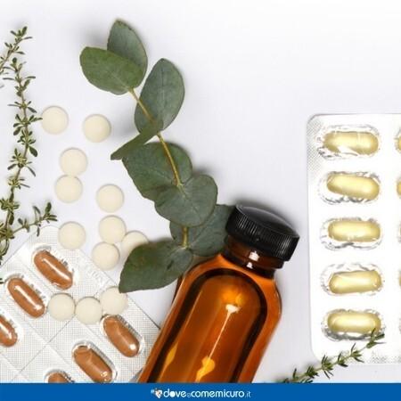 Immagine che rappresenta pastiglie e erbe