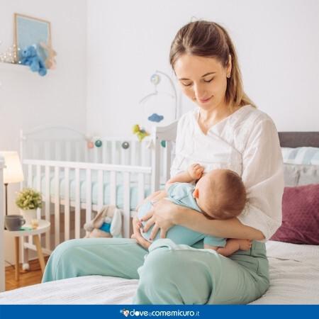 Immagine che rappresenta una madre che allatta al seno